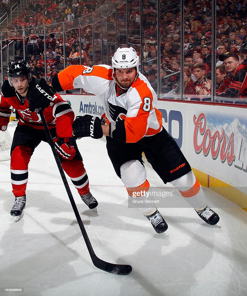 <a gi-track='captionPersonalityLinkClicked' href=/galleries/search?phrase=Nicklas+Grossman&family=editorial&specificpeople=2284863 ng-click='$event.stopPropagation()'>Nicklas Grossman</a>n #8 of the Philadelphia Flyers skates against the New Jersey Devils at the Prudential Center on March 13, 2013 in Newark, New Jersey. The Devils defeated the Flyers 5-2.