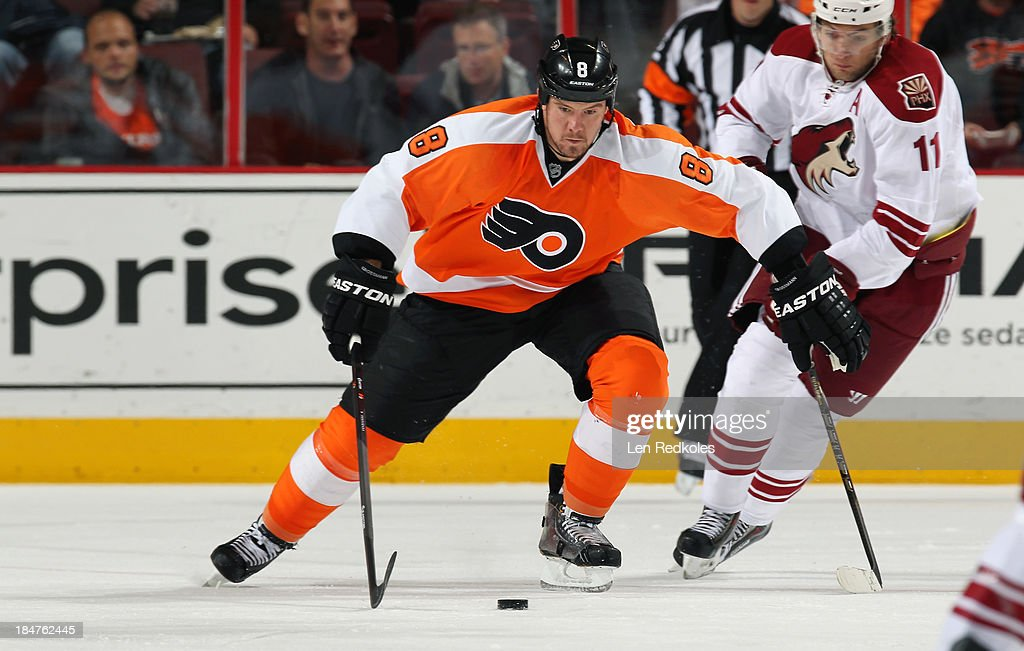 <a gi-track='captionPersonalityLinkClicked' href=/galleries/search?phrase=Nicklas+Grossman&family=editorial&specificpeople=2284863 ng-click='$event.stopPropagation()'>Nicklas Grossman</a>n #8 of the Philadelphia Flyers skates the puck against Martin Hanzal #11 of the Phoenix Coyotes on October 11, 2013 at the Wells Fargo Center in Philadelphia, Pennsylvania.
