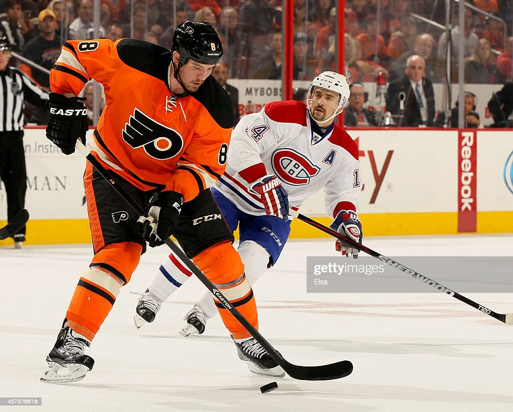 Nicklas Grossmann of the Philadelphia Flyers takes the puck as Tomas Plekanec of the Montreal Canadiens defends on October 11 2014 at the Wells Fargo...