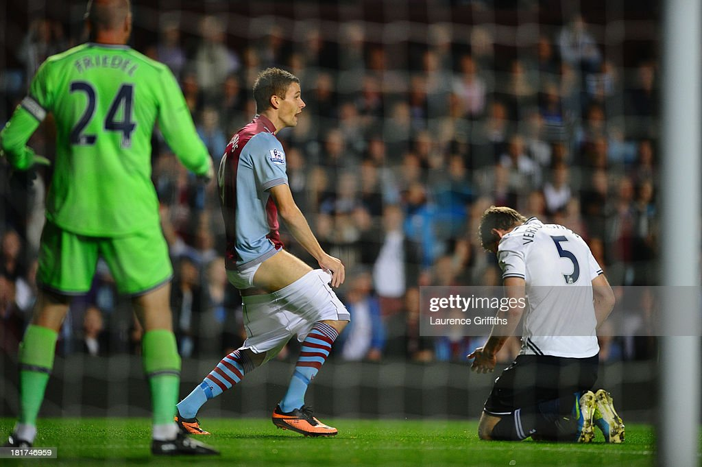 Nicklas Helenius of Aston Villa complains to the referee after having his shorts pulled down by <a gi-track='captionPersonalityLinkClicked' href=/galleries/search?phrase=Jan+Vertonghen&family=editorial&specificpeople=1360499 ng-click='$event.stopPropagation()'>Jan Vertonghen</a> of Tottenham Hotspur during the Capital One Cup third round match between Aston Villa and Tottenham Hotspur at Villa Park on September 24, 2013 in Birmingham, England.