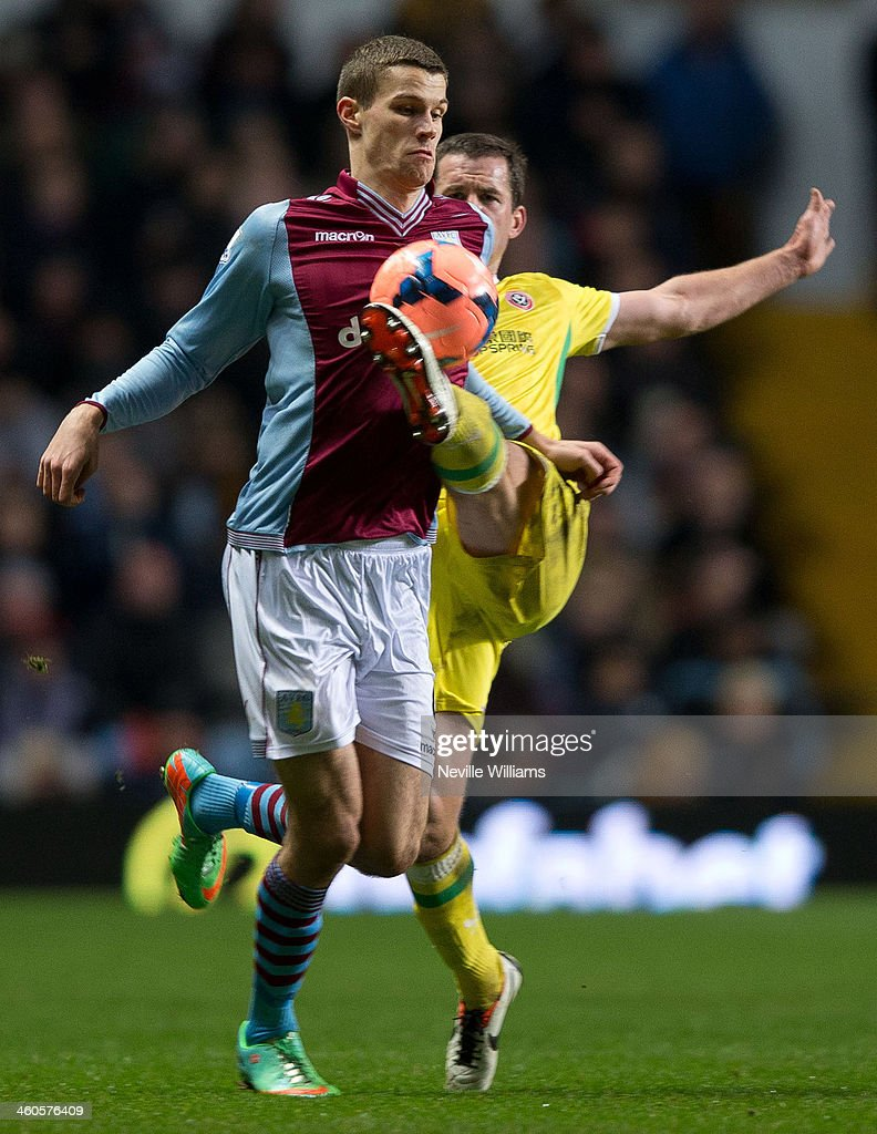 Nicklas Helenius of Aston Villa is challenged by Michael Doyle of Sheffield United during the FA Cup Third Round match between Aston Villa and Sheffield United at Villa Park on January 04, 2014 in Birmingham, England.