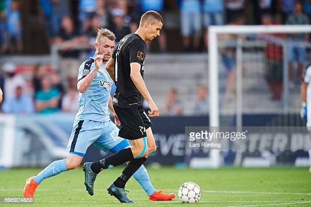 Nicklas Helenius of SIlkeborg IF and Mads Fenger of Randers FC compete for the ball during the Danish Alka Superliga match between Randers FC and...
