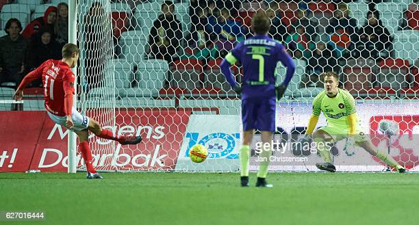 Nicklas Helenius of Silkeborg IF score at penalty kick against Goalkeeper Johan Dahlin of FC Midtjylland during the Danish Alka Superliga match...