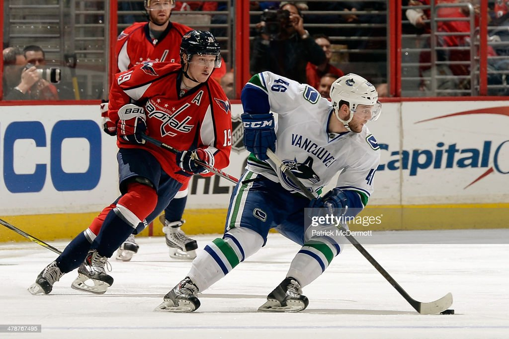 <a gi-track='captionPersonalityLinkClicked' href=/galleries/search?phrase=Nicklas+Jensen&family=editorial&specificpeople=7444168 ng-click='$event.stopPropagation()'>Nicklas Jensen</a> #46 of the Vancouver Canucks controls the puck in the third period during an NHL game against the Washington Capitals at Verizon Center on March 14, 2014 in Washington, DC.