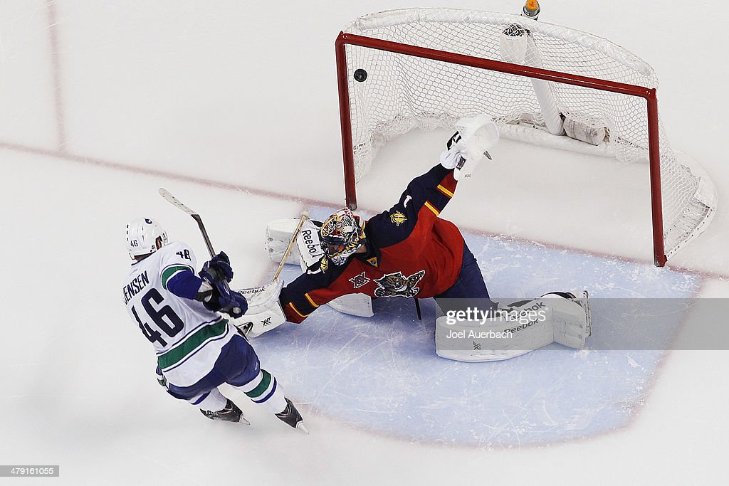 <a gi-track='captionPersonalityLinkClicked' href=/galleries/search?phrase=Nicklas+Jensen&family=editorial&specificpeople=7444168 ng-click='$event.stopPropagation()'>Nicklas Jensen</a> #46 of the Vancouver Canucks scores the game winning goal in the shootout against goaltender <a gi-track='captionPersonalityLinkClicked' href=/galleries/search?phrase=Roberto+Luongo&family=editorial&specificpeople=202638 ng-click='$event.stopPropagation()'>Roberto Luongo</a> #1 the Florida Panthers at the BB&T Center on March 16, 2014 in Sunrise, Florida. Vancouver defeated the Panthers 4-3 in a shootout.