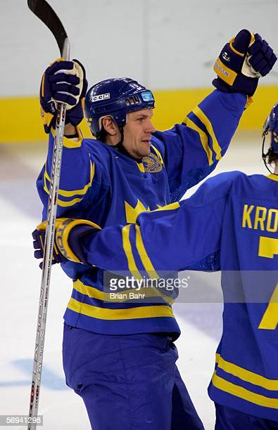Nicklas Lidstrom of Sweden celebrates his third period goal to take a 32 lead over Finland during the final of the men's ice hockey match between...