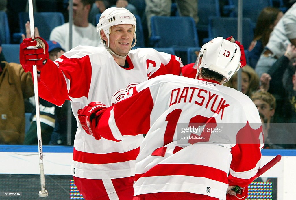 Nicklas Lidstrom #5 of the Detroit Red Wings celebrates with Pavel Datsyuk #13 after assisting on teammate Henrik Zetterberg's (not pictured) overtime goal against the New York Islanders on January 30, 2007 at Nassau Coliseum in Uniondale, New York.