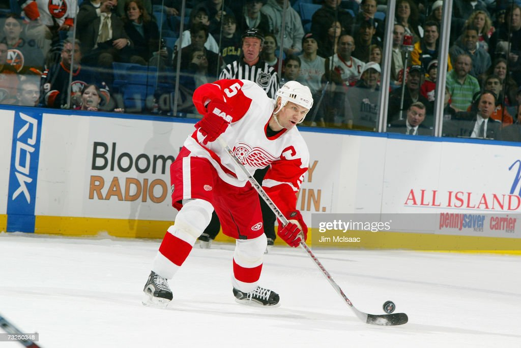 <a gi-track='captionPersonalityLinkClicked' href=/galleries/search?phrase=Nicklas+Lidstrom&family=editorial&specificpeople=201470 ng-click='$event.stopPropagation()'>Nicklas Lidstrom</a> #5 of the Detroit Red Wings handles the puck against the New York Islanders on January 30, 2007 at Nassau Coliseum in Uniondale, New York. The Red Wings won 4-3 in overtime.