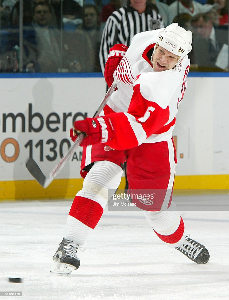 <a gi-track='captionPersonalityLinkClicked' href=/galleries/search?phrase=Nicklas+Lidstrom&family=editorial&specificpeople=201470 ng-click='$event.stopPropagation()'>Nicklas Lidstrom</a> #5 of the Detroit Red Wings shoots the puck against the New York Islanders on January 30, 2007 at Nassau Coliseum in Uniondale, New York.