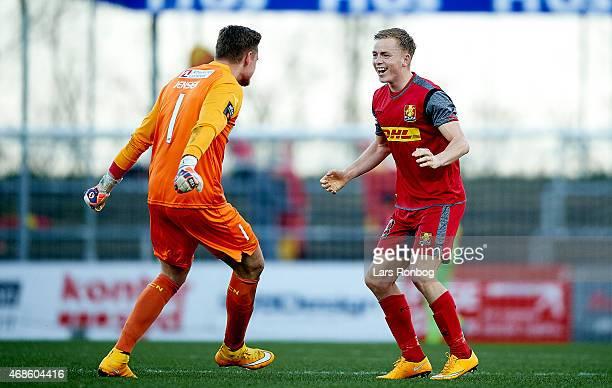 Nicklas Mouritsen of FC Nordsjalland celebrates their victory with team mate Goalkeeper David Jensen after the Danish Alka Superliga match between...