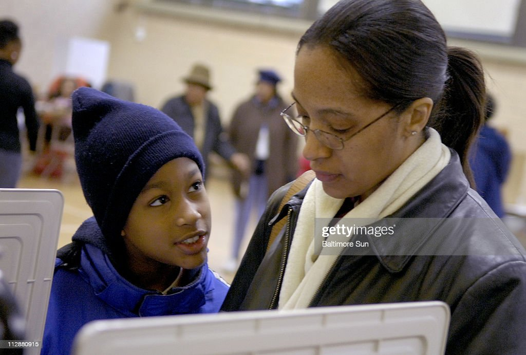 Nickol Weaver, a social worker, voted for Sen. Hillary Clinton, while her 9-year-old son Earl Weaver Jr., said he likes Sen. Barack Obama for president on Tuesday, February 12, 2008, at Gwynns Falls Elementary School in Baltimore, Maryland.