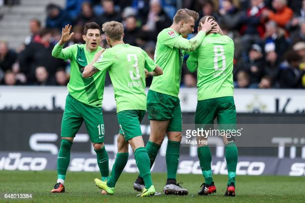 Nicky Adler of Aue celebrates with his teammates after scoring his team's equalizing goal to make it 22 during the Second Bundesliga match between...