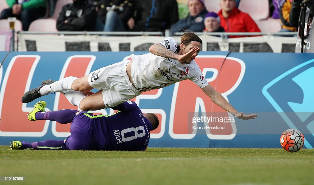 Nicky Adler of Aue challenges Lukas Billick of Wuerzburg during the Third League match between FC Erzgebirge Aue and Wuerzburger Kickers at Erzgebirgsstadion on February 14, 2016 in Aue, Germany.