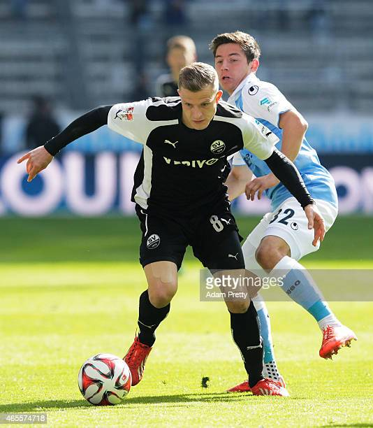 Nicky Adler of SV Sandhausen is challenged by Maximilian Wittek of 1869 Muenchen during the 2 Bundesliga match between 1860 Muenchen and SV...