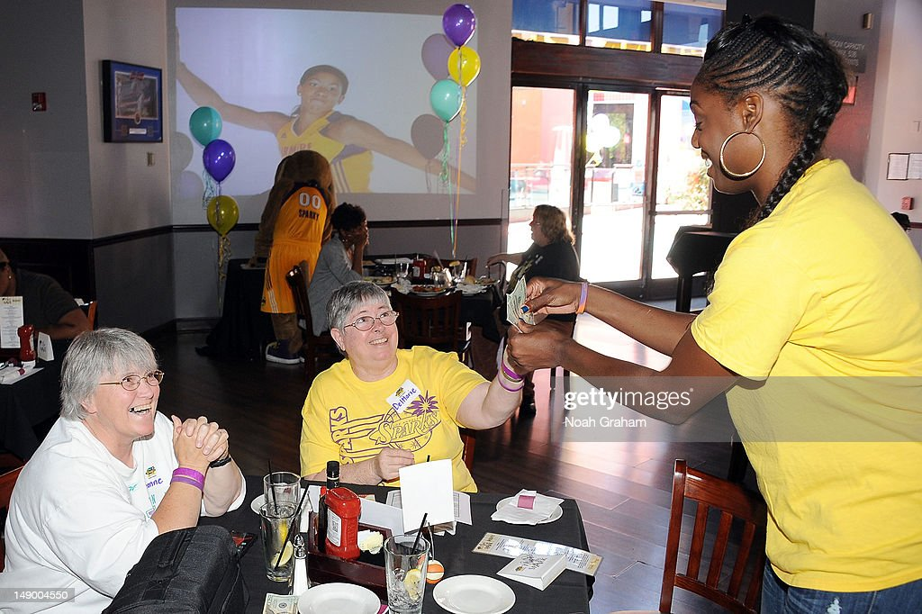 Nicky Anosike of the Los Angeles Sparks accepts a tip during the teams annual TipASpark Fundraising Event at Jillian's Universal CityWalk on July 21...