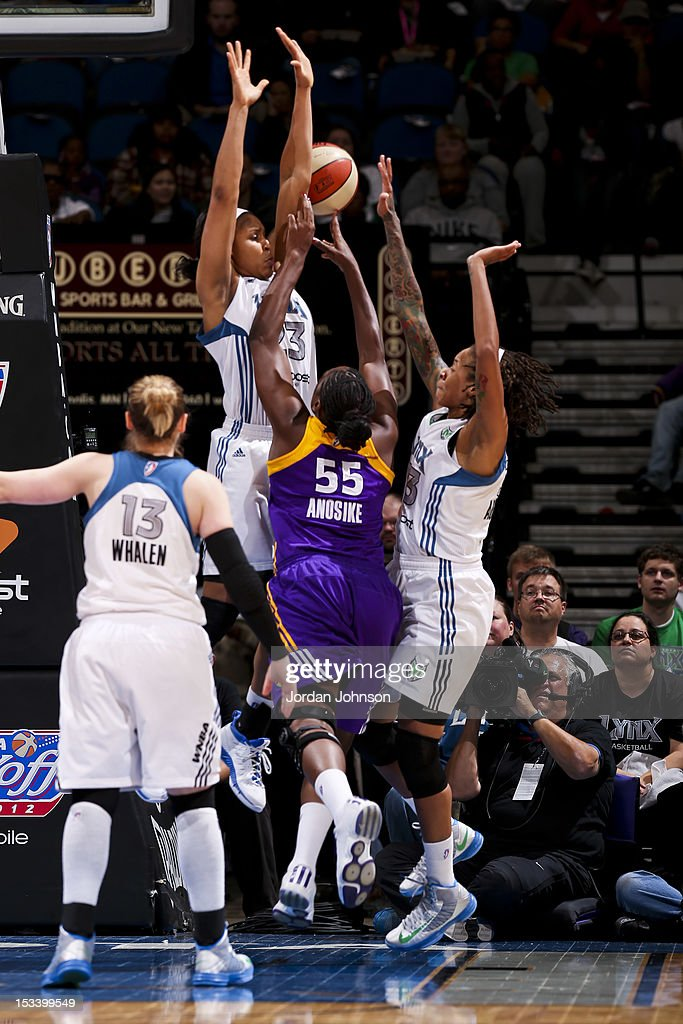 Nicky Anosike #55 of the Los Angeles Sparks attempts a shot against Maya Moore #23 and Seimone Augustus #33 of the Minnesota Lynx during Game One of the 2012 WNBA Western Conference Finals on October 4, 2012 at Target Center in Minneapolis, Minnesota.