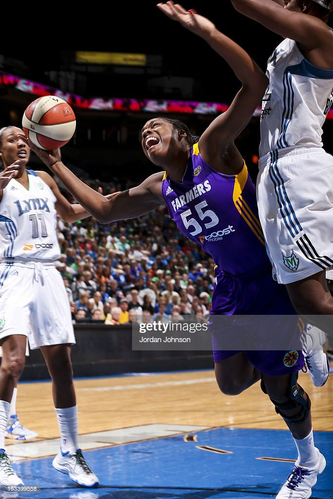 Nicky Anosike of the Los Angeles Sparks attempts a shot against Rebekkah Brunson of the Minnesota Lynx during Game One of the 2012 WNBA Western...