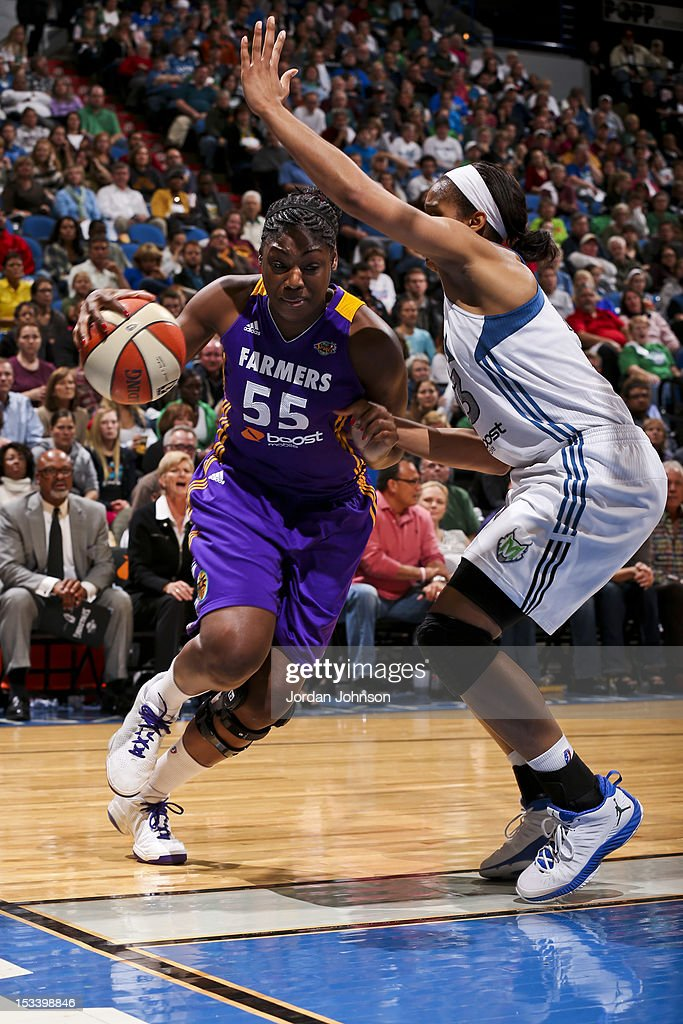 Nicky Anosike of the Los Angeles Sparks drives the ball against Maya Moore of the Minnesota Lynx during Game One of the 2012 WNBA Western Conference...