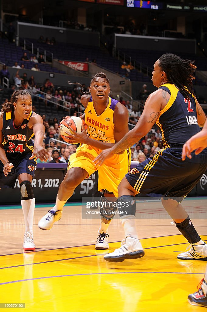 Nicky Anosike of the Los Angeles Sparks drives to the basket during a game against the Indiana Fever at Staples Center on June 24 2012 in Los Angeles...