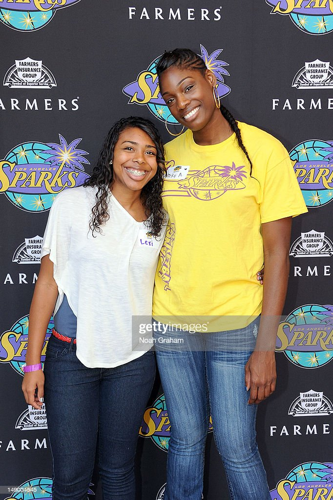 Nicky Anosike of the Los Angeles Sparks poses for a picture with a fan during the teams annual TipASpark Fundraising Event at Jillian's Universal...