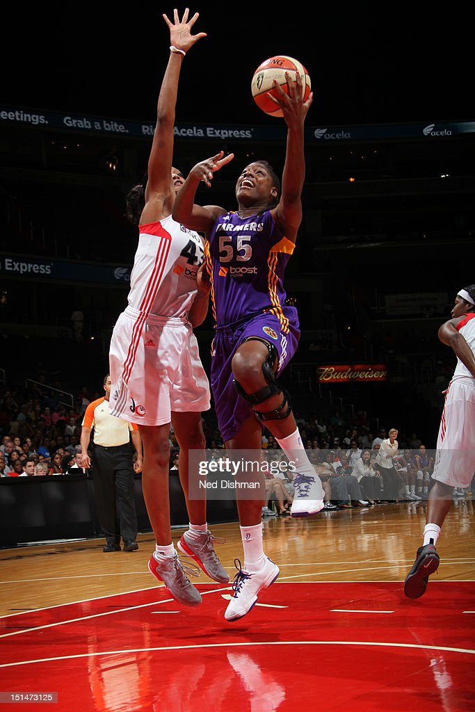 Nicky Anosike of the Los Angeles Sparks shoots against Ashley Robinson of the Washington Mystics at the Verizon Center on September 7 2012 in...