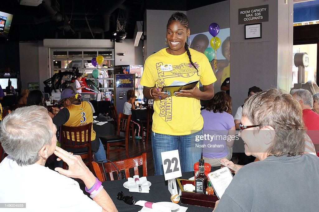 Nicky Anosike of the Los Angeles Sparks takes an order during the annual TipASpark Fundraising Event at Jillian's Universal CityWalk on July 21 2012...