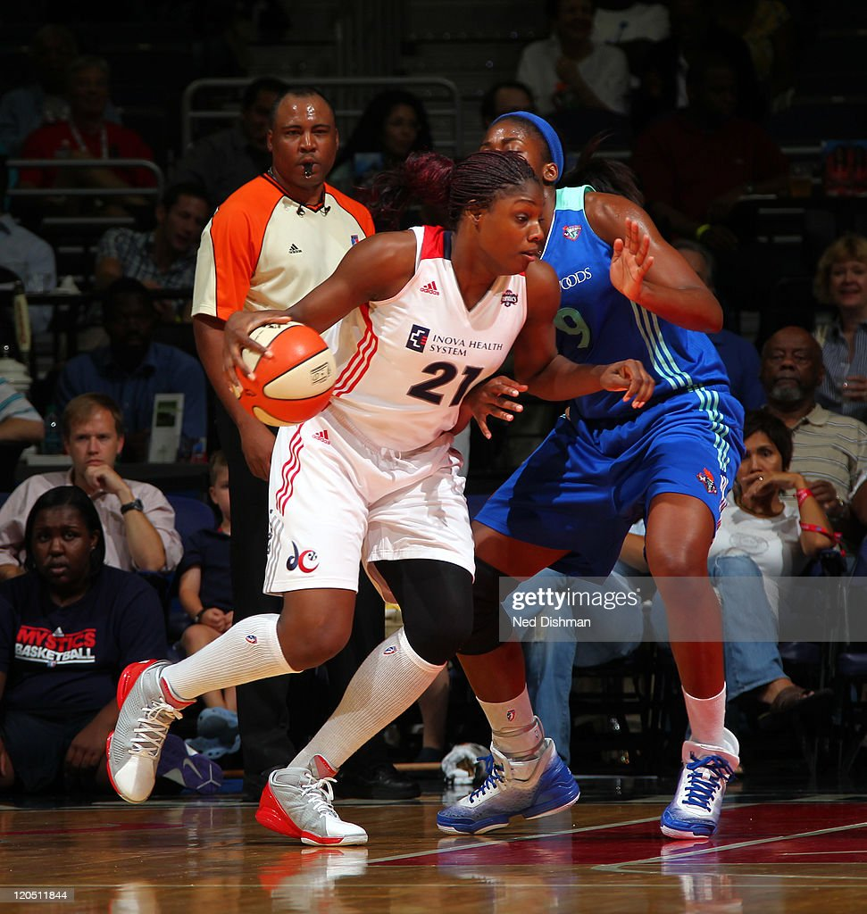 Nicky Anosike of the Washington Mystics drives against the New York Liberty at the Verizon Center on August 6 2011 in Washington DC NOTE TO USER User...
