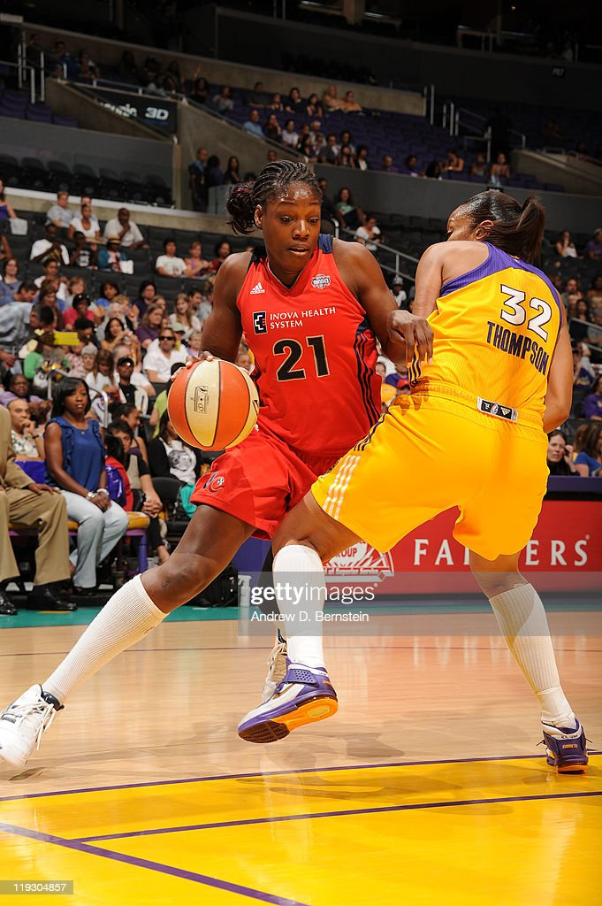 Nicky Anosike of the Washington Mystics drives against Tina Thompson of the Los Angeles Sparks during a game at Staples Center on July 17 2011 in Los...