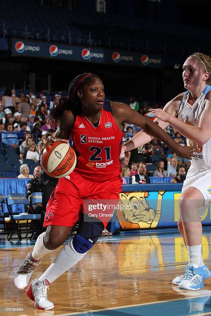 Nicky Anosike of the Washington Mystics drives past Carolyn Swords of the Chicago Sky during the WNBA game on August 26 2011 at the AllState Arena in...