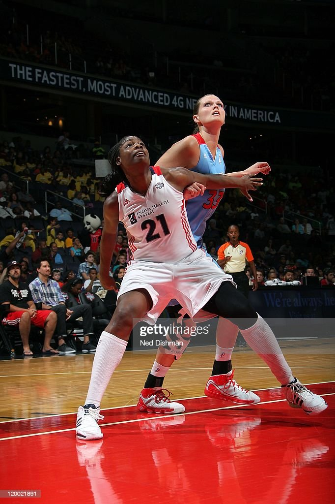 Nicky Anosike of the Washington Mystics posts up on Alison Bales of the Atlanta Dream during the WNBA game at the Verizon Center on July 20 2011 in...