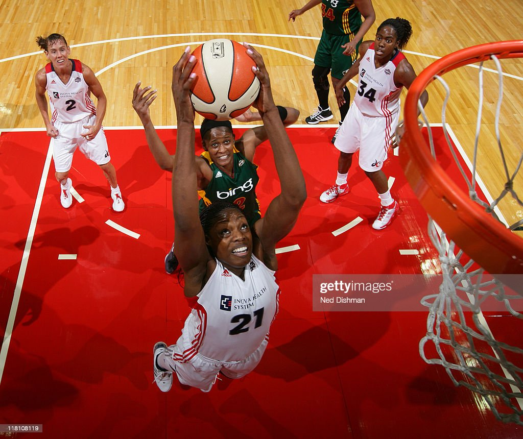 Nicky Anosike of the Washington Mystics rebounds against Swin Cash of the Seattle Storm at the Verizon Center on July 3 2011 in Washington DC NOTE TO...