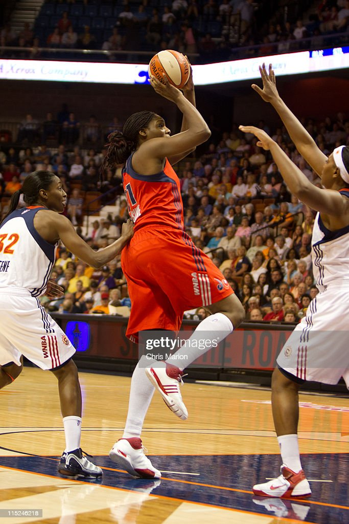 Nicky Anosike of the Washington Mystics shoots in the paint against the Connecticut Sun at the Mohegan Sun Arena on June 04 2011 in Uncasville...
