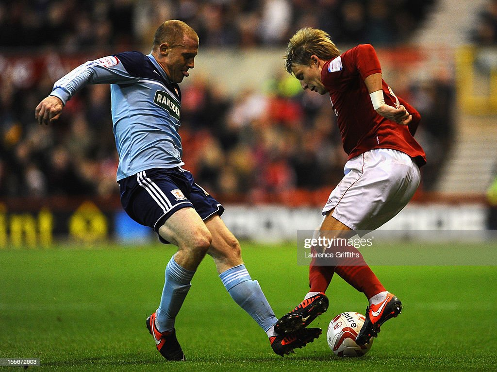 Nicky Bailey of Middlesbrough battles with Dan Harding of Nottingham Forest during the npower Championship match between Nottingham Forest and Middlesbrough at the City Ground on November 6, 2012 in Nottingham, England.
