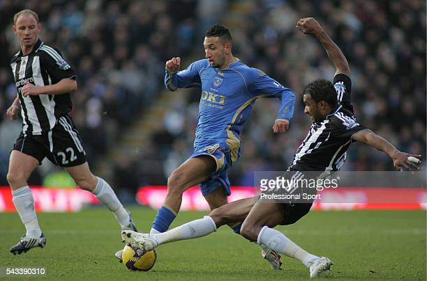 Nicky Butt and Habib Beye of Newcastle United and Nadir Belhadj of Portsmouth in action during the Barclays Premier League match between Portsmouth...