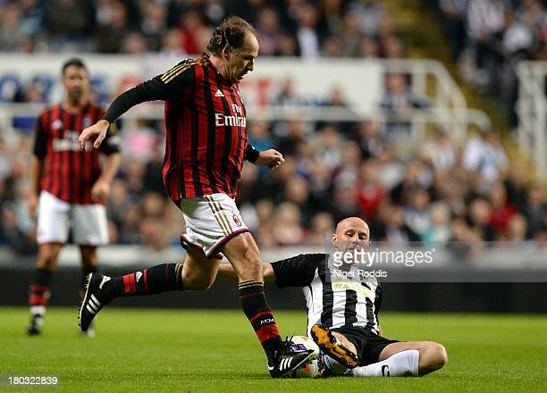 Nicky Butt of Newcastle United vies for the ball with Franco Baresi of AC Milan during Steve Harper's testimonial match between Newcastle United and...