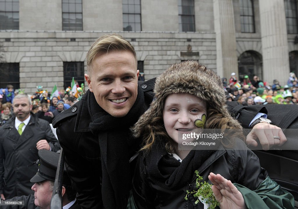 Nicky Byrne and Robyn O'Shaughnessy Grand Marshalls of the Saint Patrick's Parade pose during St Patrick's Day festivities on March 17, 2013 in Dublin, Ireland. More than 100 parades are being held across Ireland to mark St Patrick's Day, the feast day of the patron saint of Ireland, with up to 650,000 spectators expected to attend the parade in Dublin. Ireland has high hopes that the festivities will bring a much-needed boost to the economy.er caption here on March 17, 2013 in Dublin, Ireland.