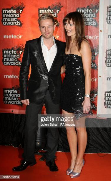 Nicky Byrne of Westlife and his wife Georgina Ahern Byrne arriving at the Meteor Ireland Music Awards 2009 at the RDS Dublin Ireland
