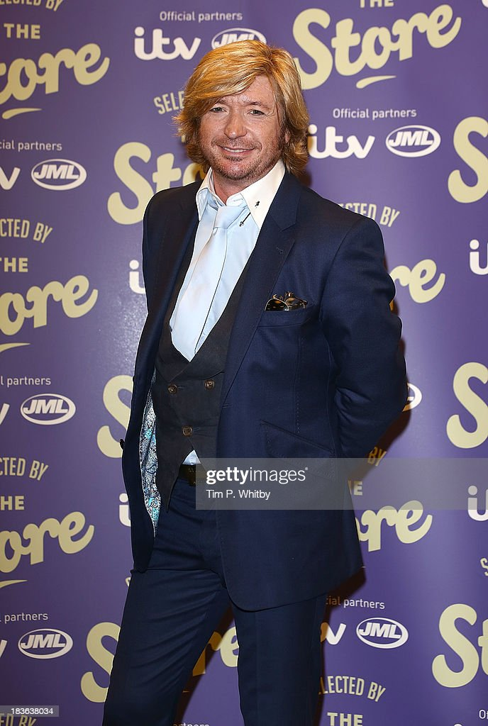 <a gi-track='captionPersonalityLinkClicked' href=/galleries/search?phrase=Nicky+Clarke+-+Hairdresser&family=editorial&specificpeople=224837 ng-click='$event.stopPropagation()'>Nicky Clarke</a> attends a photocall to launch new shopping channel 'The Store' at BAFTA on October 8, 2013 in London, England.