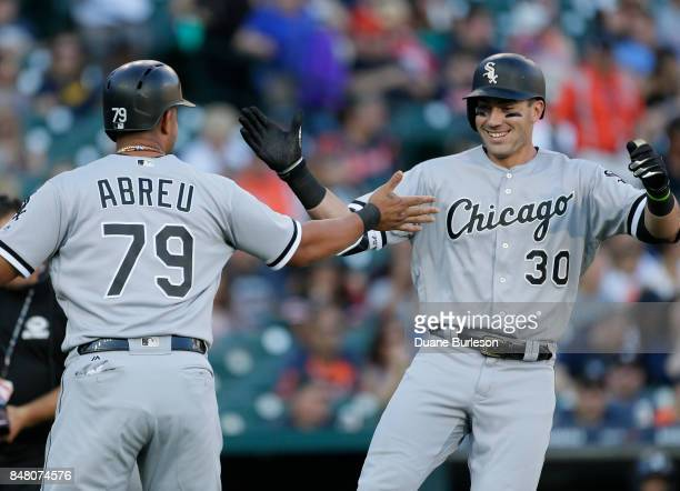 Nicky Delmonico of the Chicago White Sox celebrates with Jose Abreu of the Chicago White Sox after hitting a tworun home run against the Detroit...