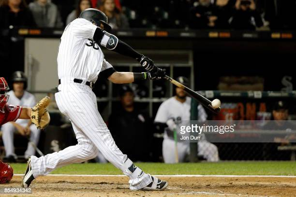 Nicky Delmonico of the Chicago White Sox hits a walkoff two run home run against the Los Angeles Angels of Anaheim during the tenth inning at...
