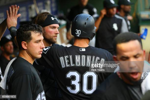 Nicky Delmonico of the Chicago White Sox is congratulates for scoring in the first inning against the Texas Rangers at Globe Life Park in Arlington...