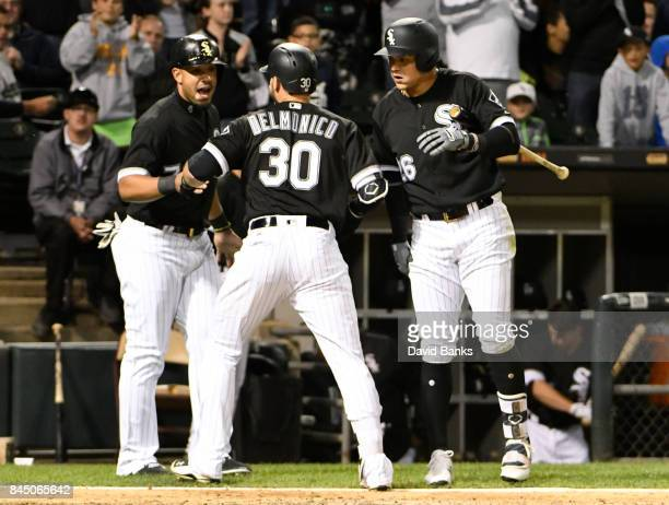 Nicky Delmonico of the Chicago White Sox is greeted by Avisail Garcia and Jose Abreu after hitting a tworun homer against the San Francisco Giants...