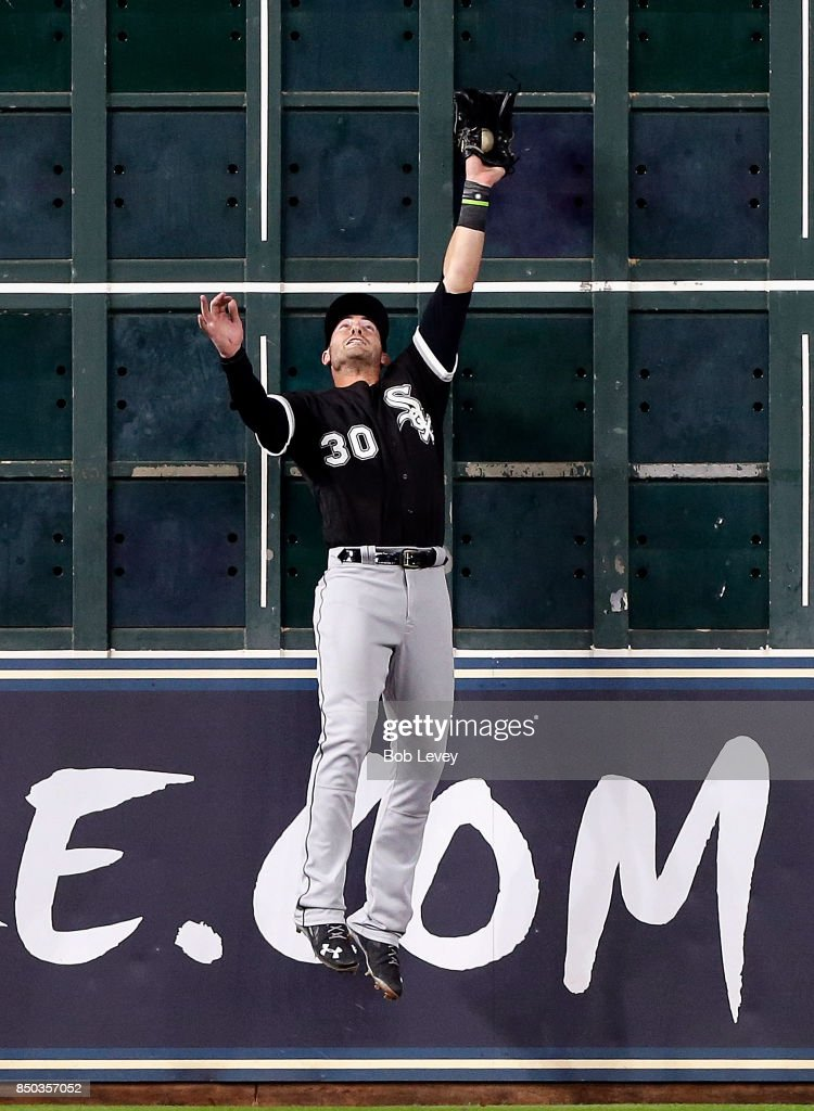 Nicky Delmonico #30 of the Chicago White Sox makes a leaping catch at the wall in the fifth inning against the Houston Astros at Minute Maid Park on September 20, 2017 in Houston, Texas.