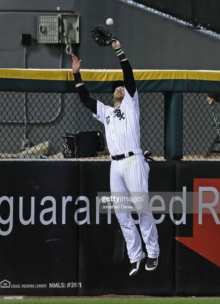 Nicky Delmonico #30 of the Chicago White Sox makes a leaping ctach at the wall on a ball hit by Francisco Lindor of the Cleveland Indians in the 7th inning at Guaranteed Rate Field on September 6, 2017 in Chicago, Illinois.