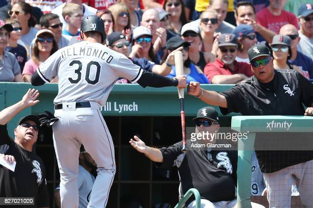 Nicky Delmonico of the Chicago White Sox returns to the dugout after scoring in the second inning of a game against the Boston Red Sox at Fenway Park...