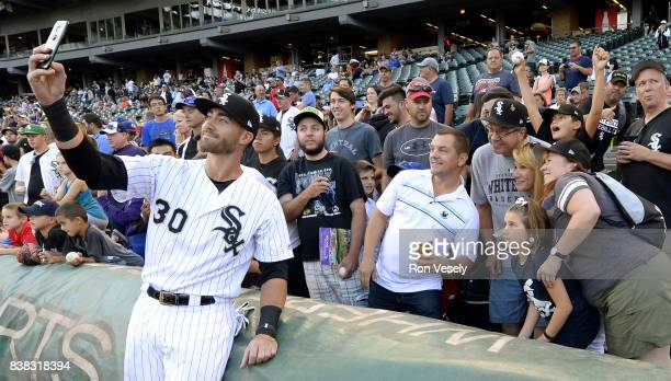 Nicky Delmonico of the Chicago White Sox takes a selfie with fans prior to the game against the Minnesota Twins on August 22 2017 at Guaranteed Rate...