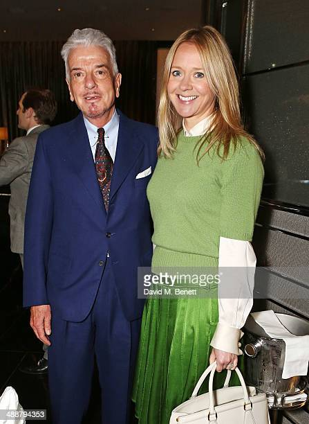 Nicky Haslam and Kate Reardon attend the launch of Alain Ducasse's Rivea restaurant at The Bulgari Hotel on May 8 2014 in London England