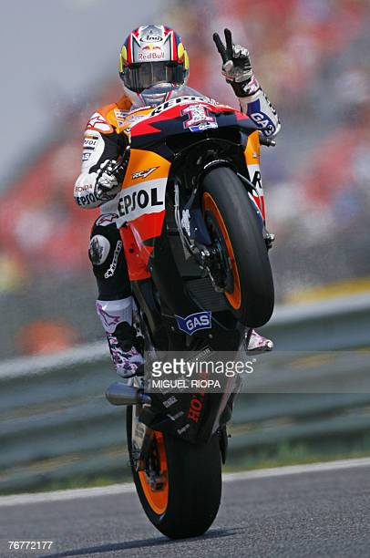 Nicky Hayden of the United States celebrates on his Honda his pool position after the moto GP qualifying practice session on the Estoril racetrack 15...