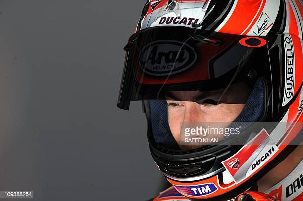 Nicky Hayden of the US leaves the Ducati pit during a MotoGP preseason second test run on the Sepang circuit near Kuala Lumpur on February 24 2011...