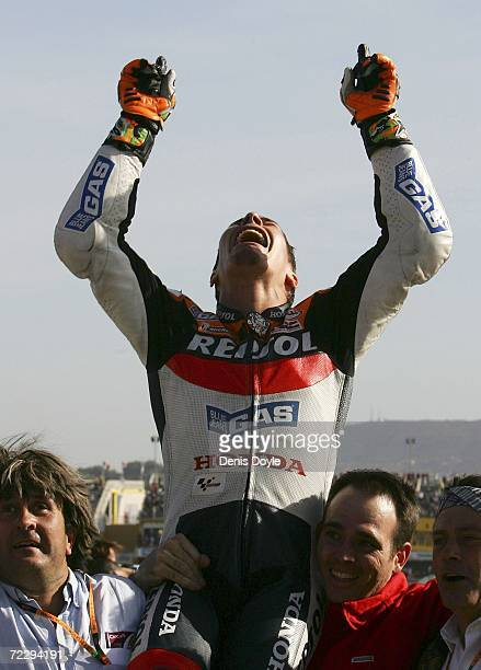 Nicky Hayden of the US reacts after clinching the World MotoGP title after finishing third in the MotoGP race in the Ricardo Torma racetrack on...